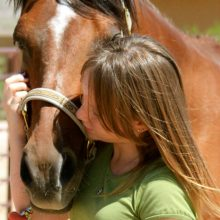 Loving Moment During Equine Therapy - Rosewood Centers For Eating Disorders