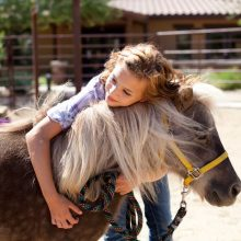 Young Patient Hugging Horse - Equine Therapy - Rosewood Centers For Eating Disorders