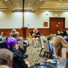 Rosewood Centers for Eating Disorders 2015 Alumni Reunion Dinner Girl Playing Guitar for the Group